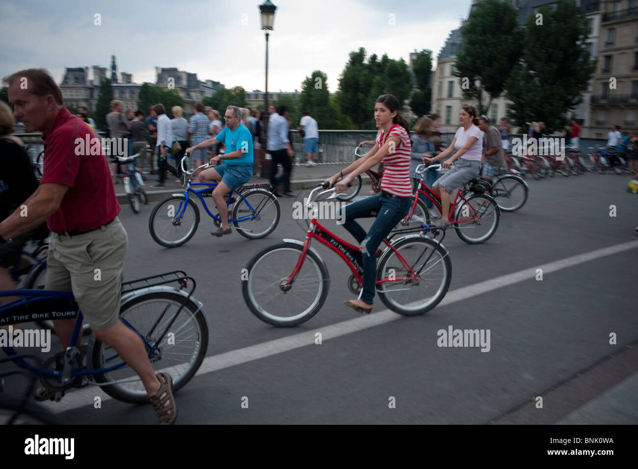 Paris Bike Tours, Group of Adult Tourists Visiting on ('Pont Saint Louis Bridge'), Biking, Ile Saint Louis, - Stock Image