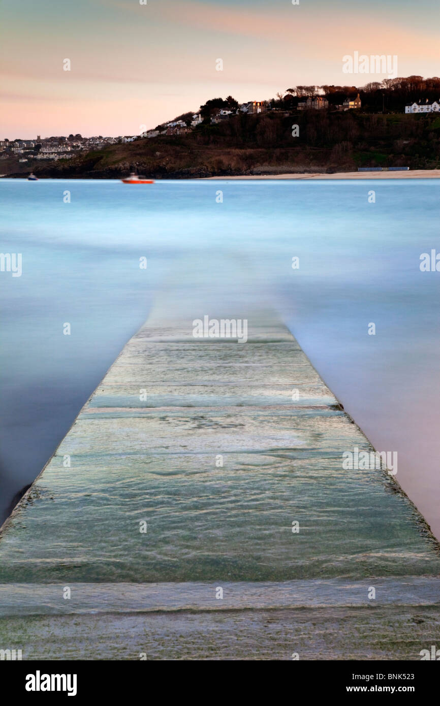 St Ives; waves over the slipway; Cornwall; long exposure; blurred motion - Stock Image