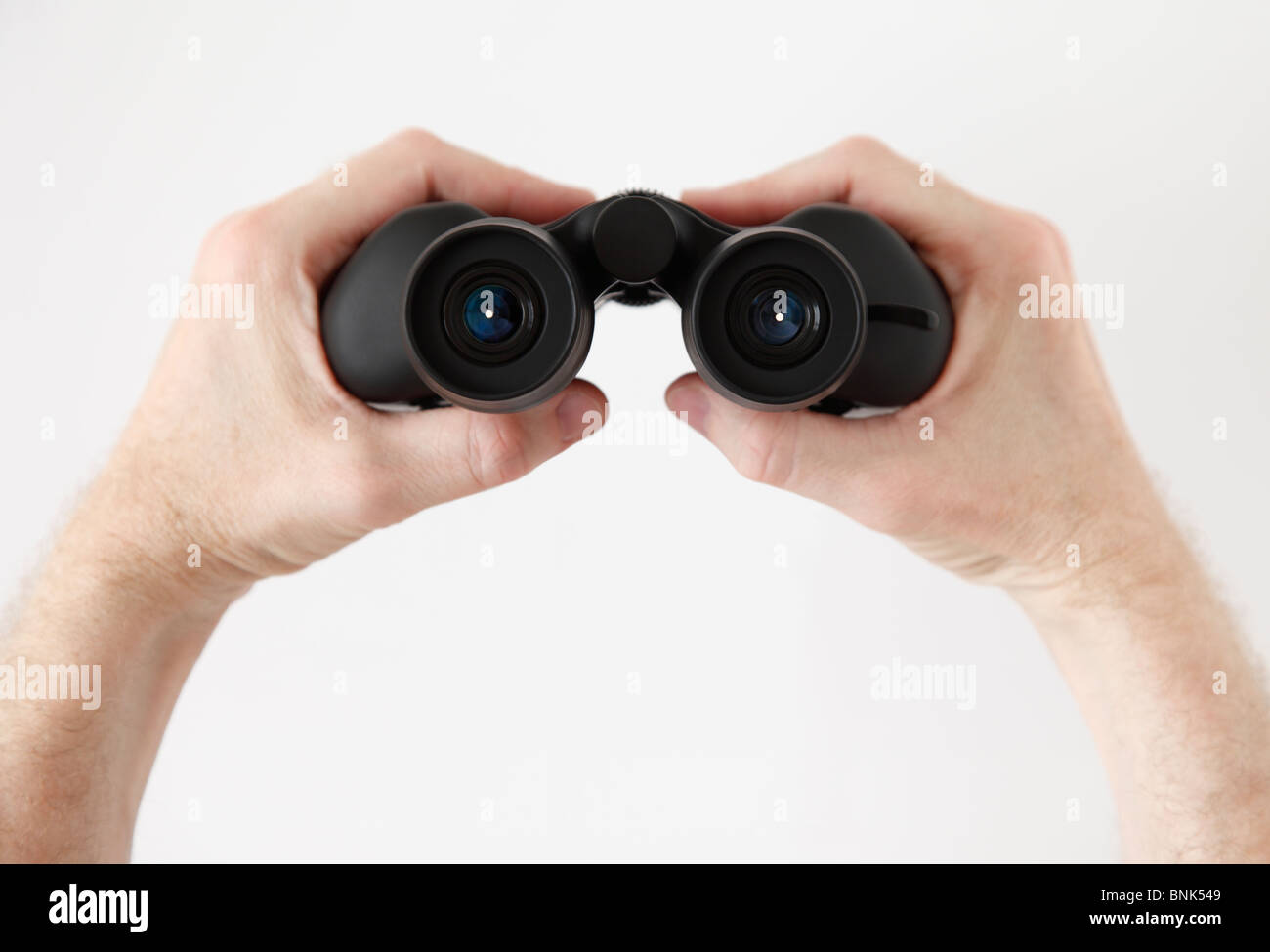 A pair of handheld Binoculars, as seen from the users point of view - Stock Image
