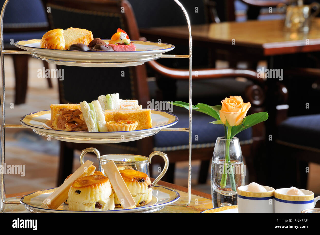 Traditional Afternoon tea in the lobby The Peninsula Hotel Hong Kong 5 star luxury hotel Afternoon tea - Stock Image