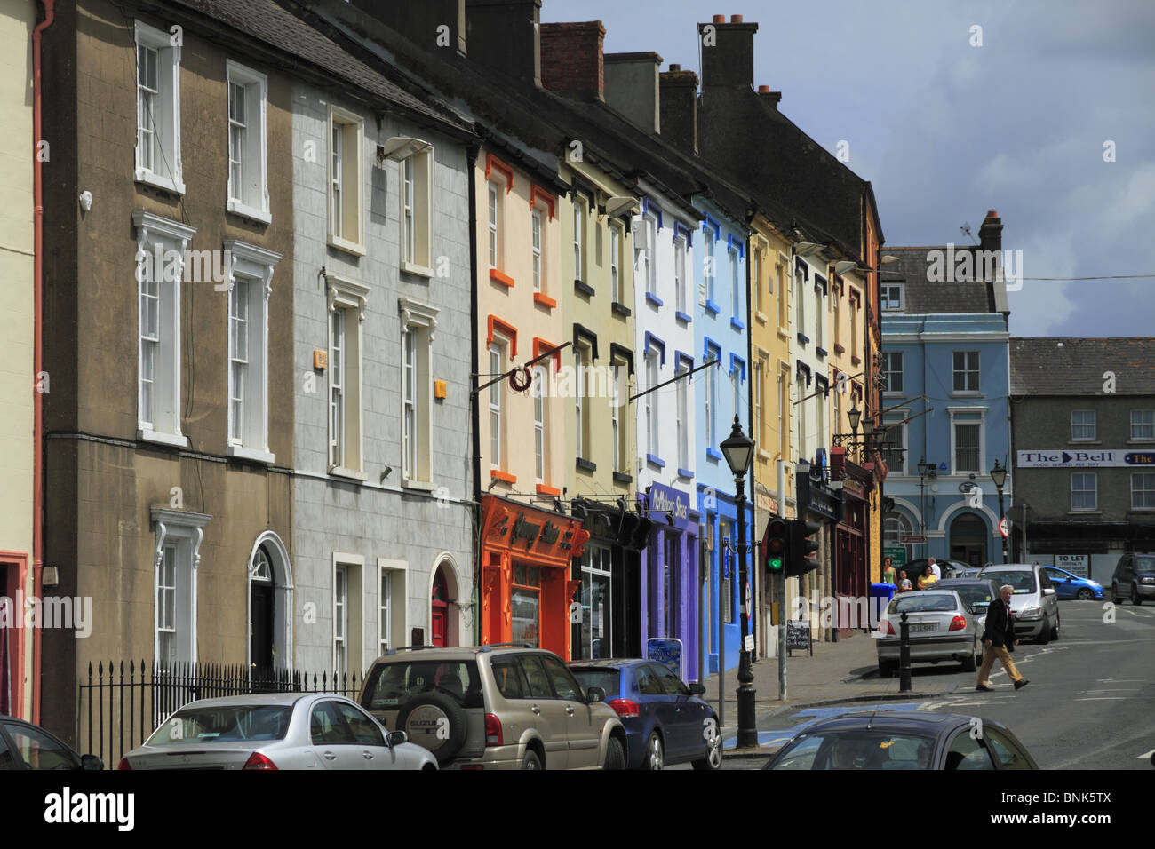 Colourful shop fronts on the main street in Cahir, Rep of Ireland. - Stock Image