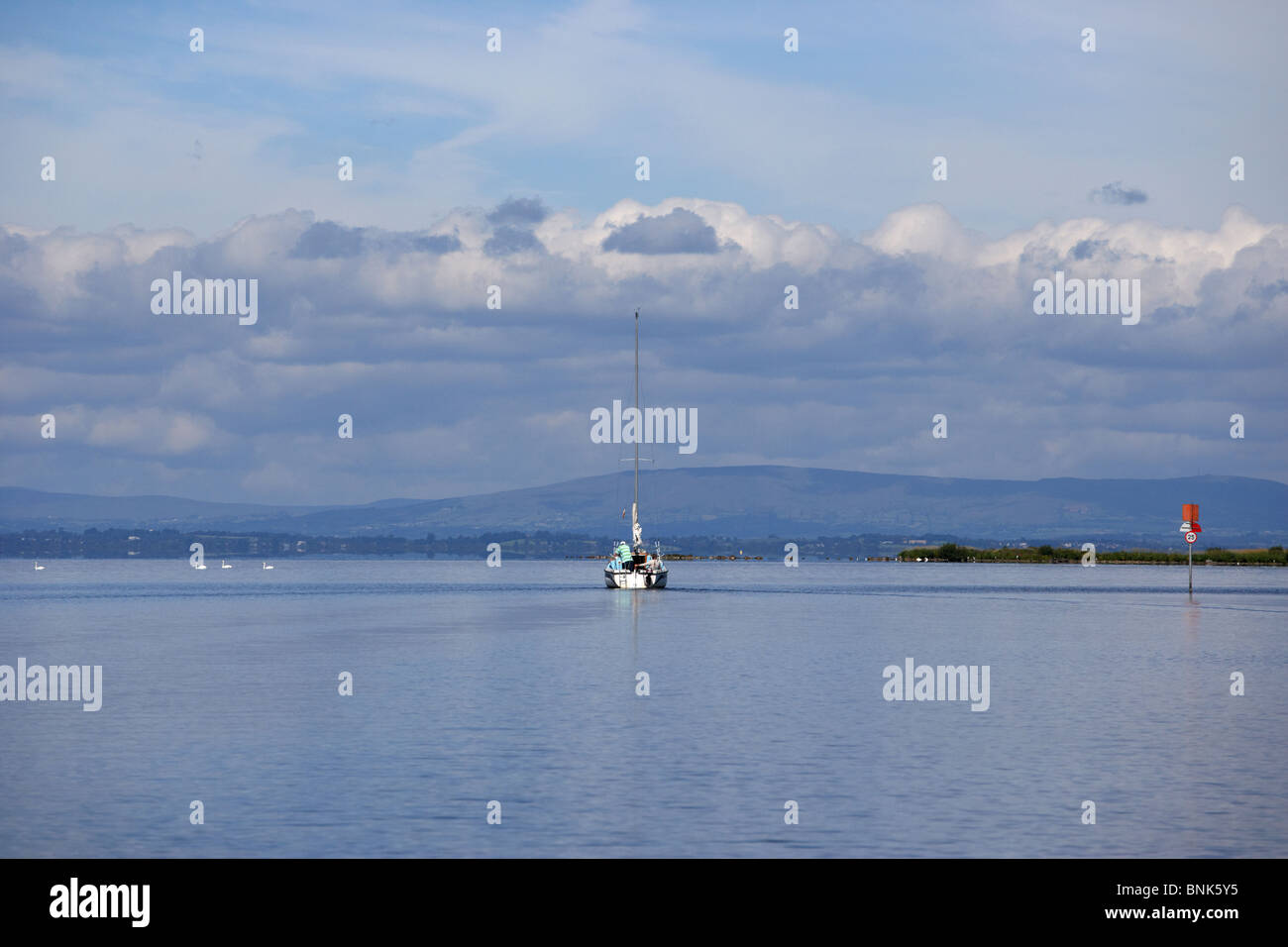 yacht motoring out to set sail on lough neagh northern ireland uk - Stock Image
