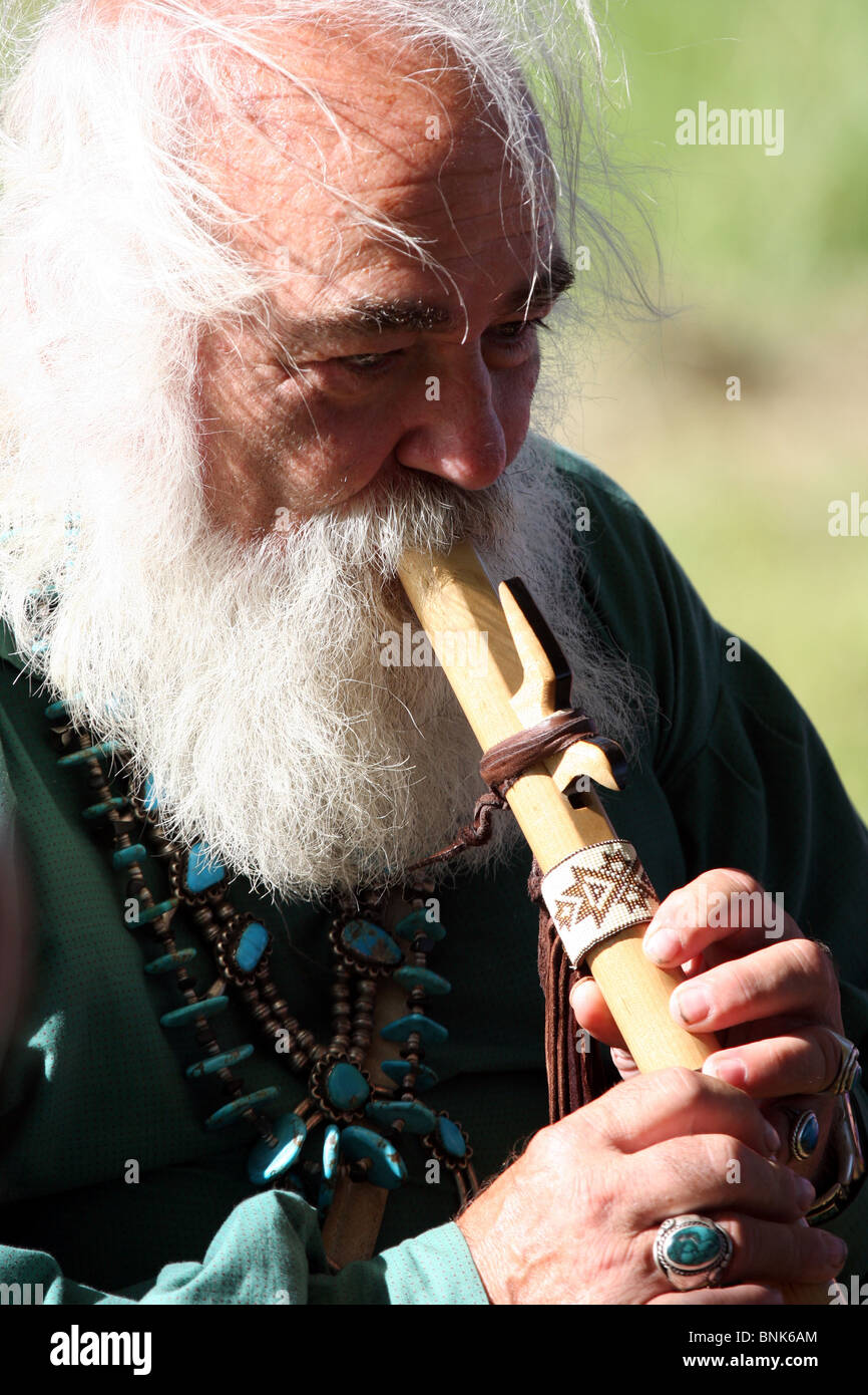 An older man playing a Native American flute Stock Photo