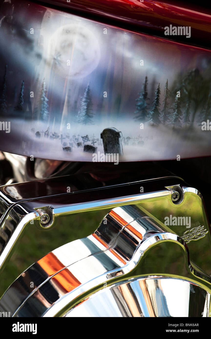 Airbrushed fantasy artwork of a ful moon on a graveyard scene painted on a Custom chopper Harley Davidson motorcycle - Stock Image