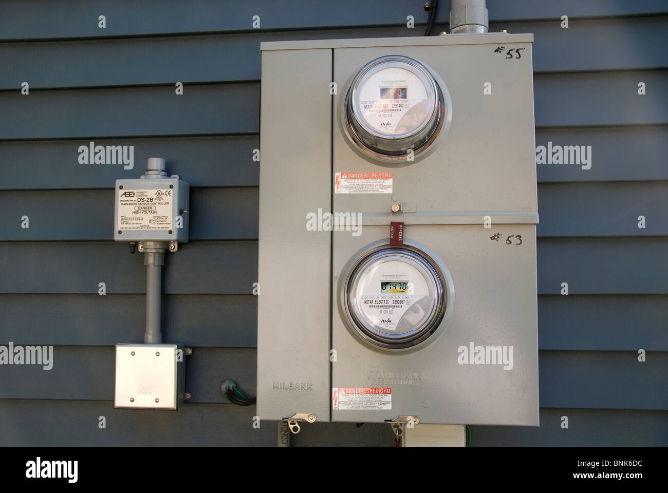 Electric meter outside residential condos - Stock Image