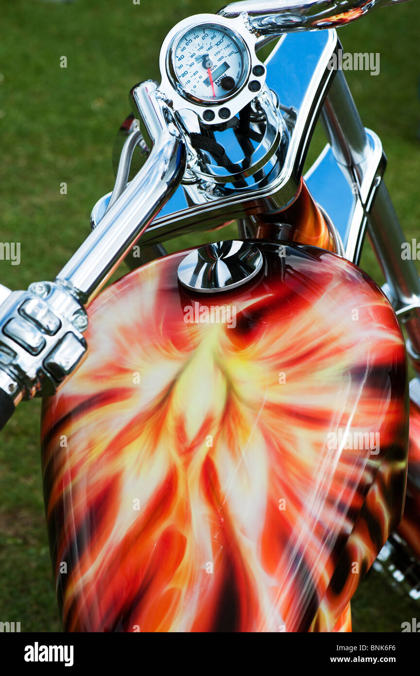 Airbrushed fantasy artwork of a phoenix painted on a Orange County Chopper motorcycle - Stock Image