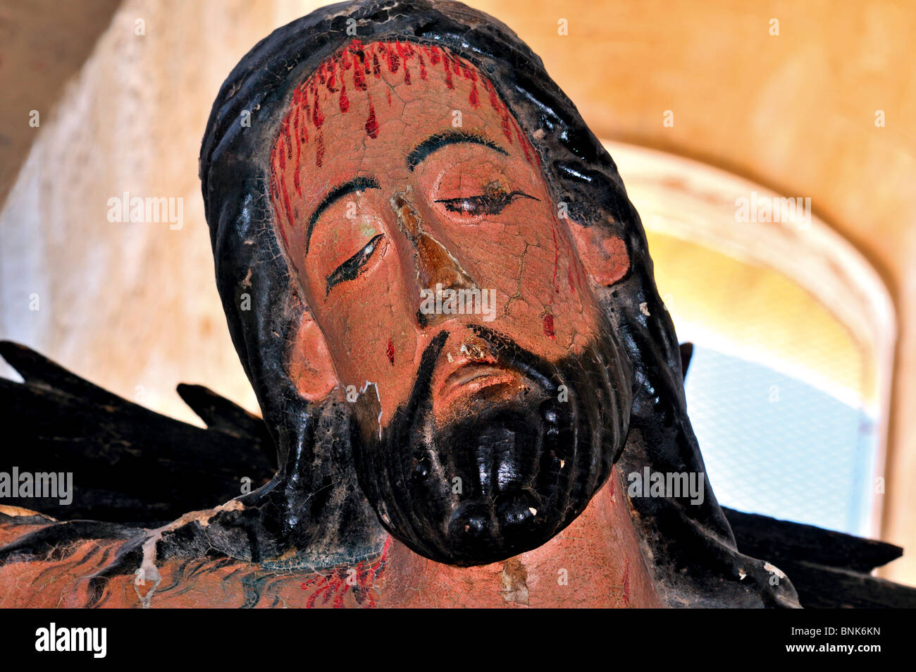 Spain, St. James Way: Detail of an romanesque sculpture of crucified Christ in the church San Martin in Fromista - Stock Image