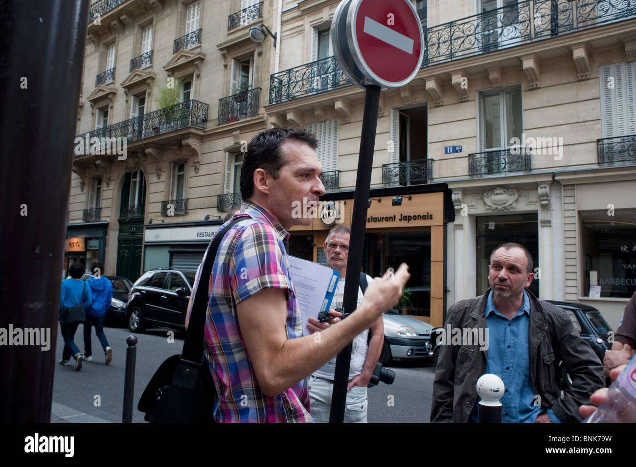 Adult Tourists Taking Gay History Tour of 1980's Paris by Tour Guide, 'Hervé Taulière'. adult - Stock Image
