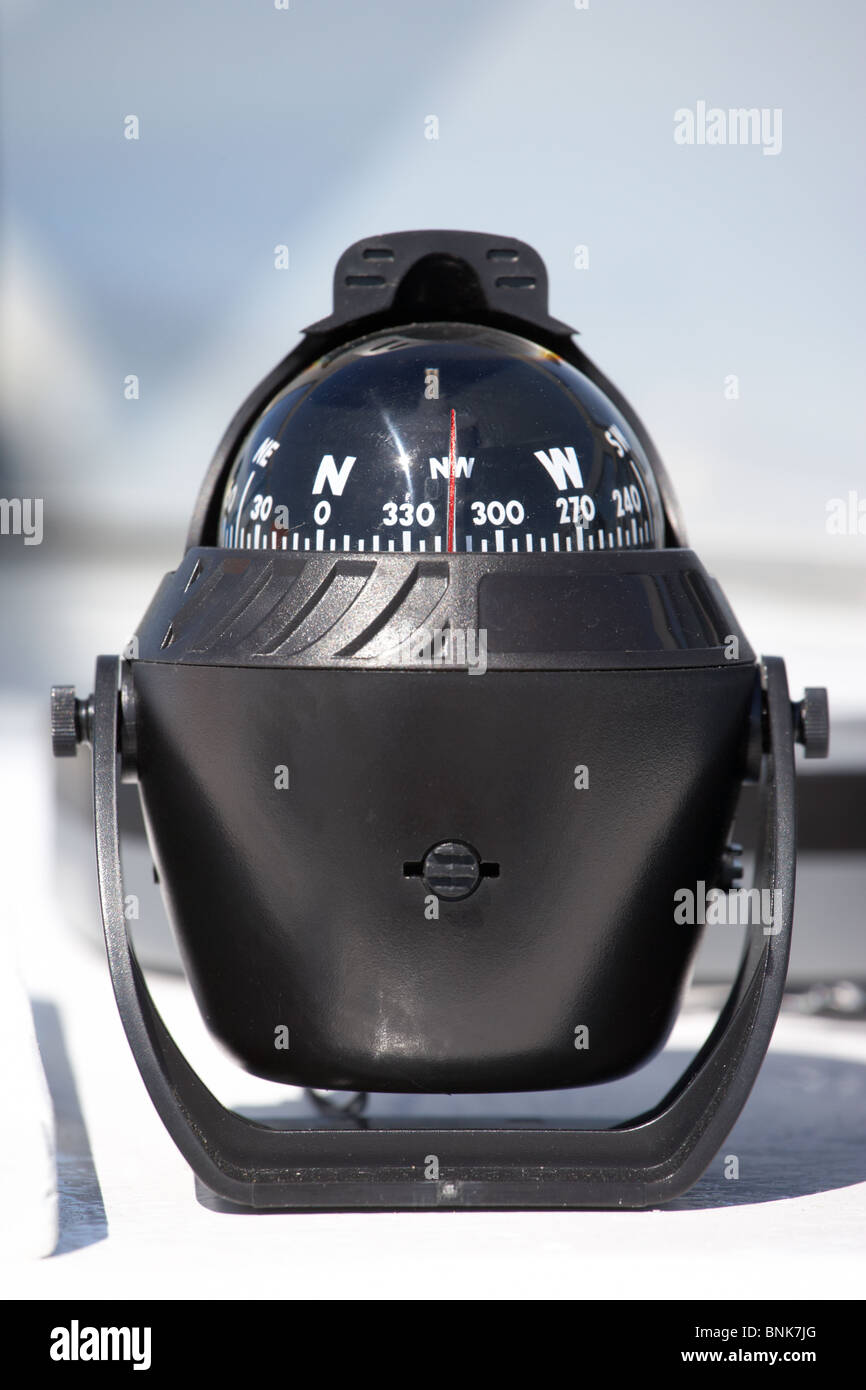 swivelling compass on a small boat for navigation - Stock Image