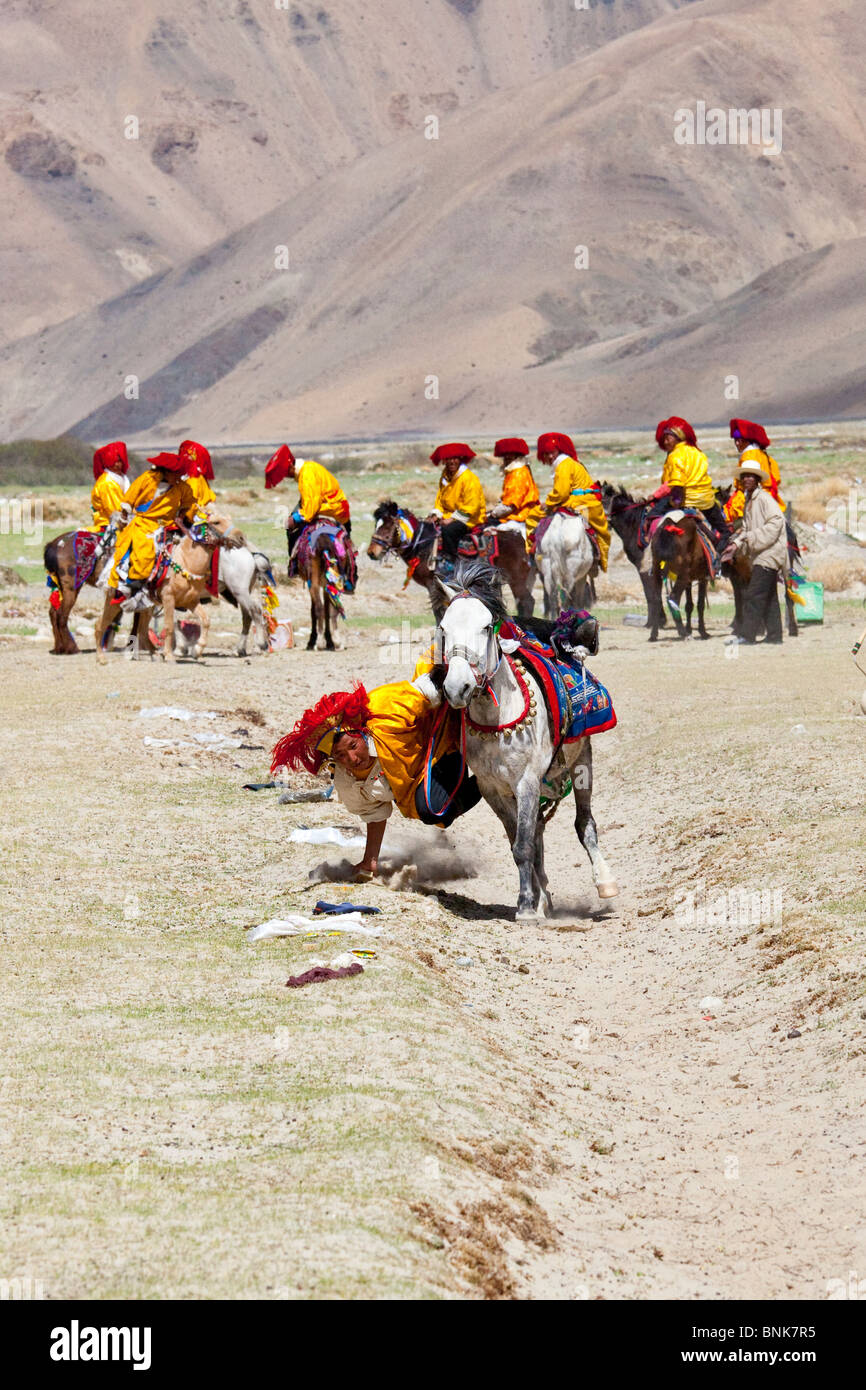 Horse competition in a village on the road to Everest Base Camp, Tibet - Stock Image