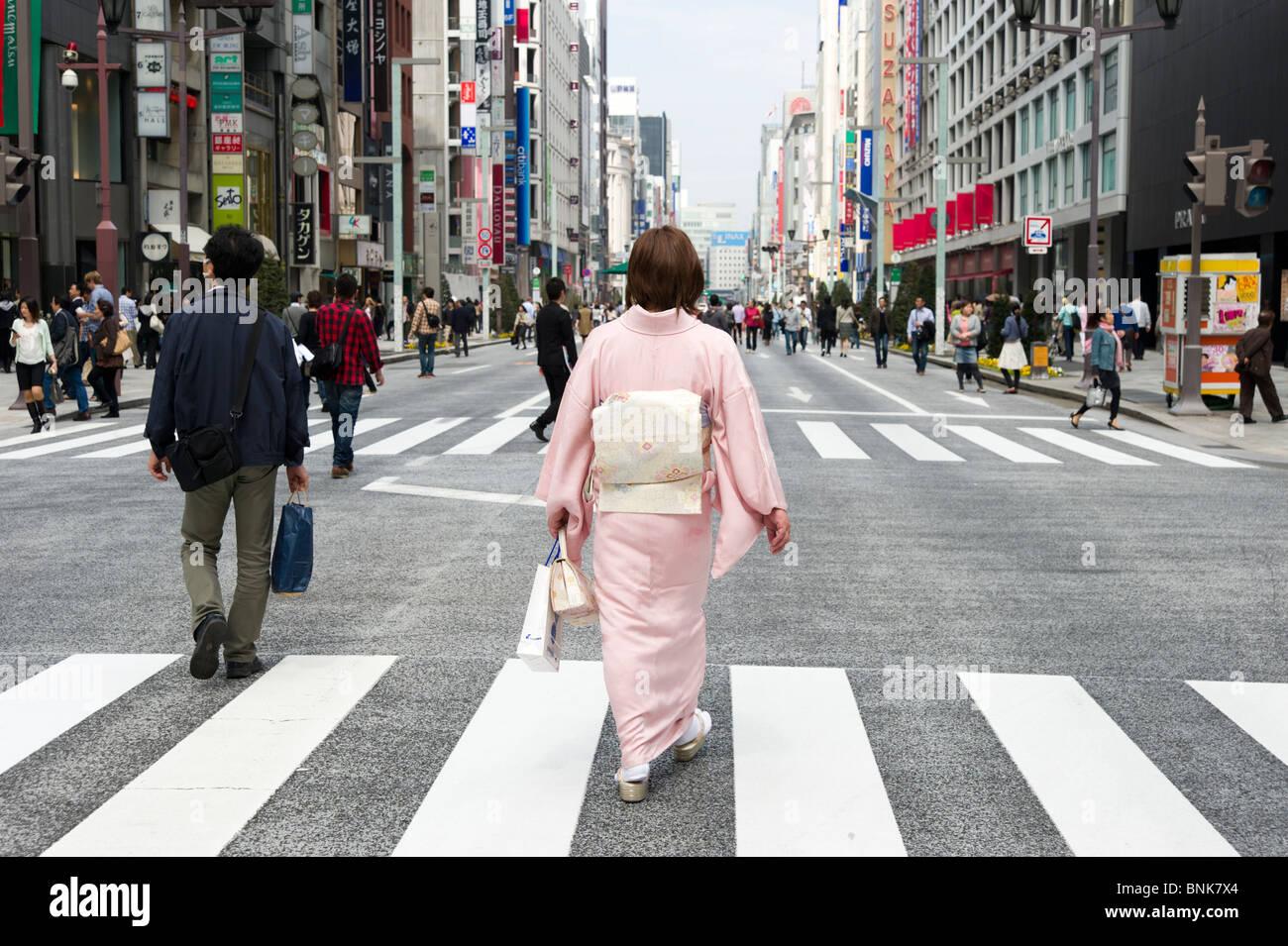 Woman wearing a kimono on Chuo-dori in Ginza 4-chome, Tokyo, Japan Stock Photo