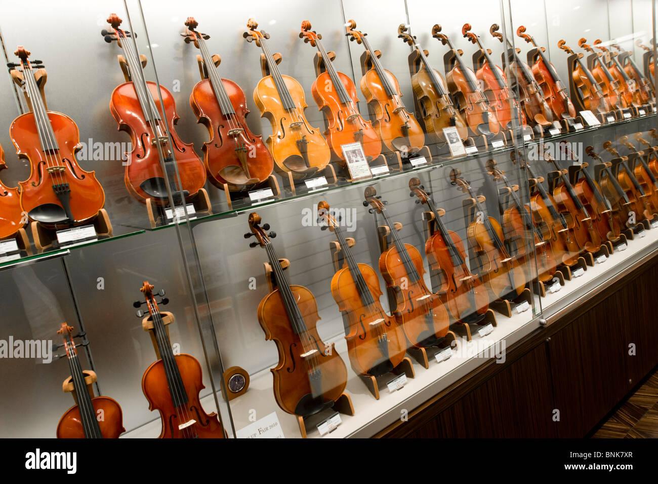 Violins in Yamaha Hall music shop in Chuo-dori, Ginza 4-chome, Tokyo