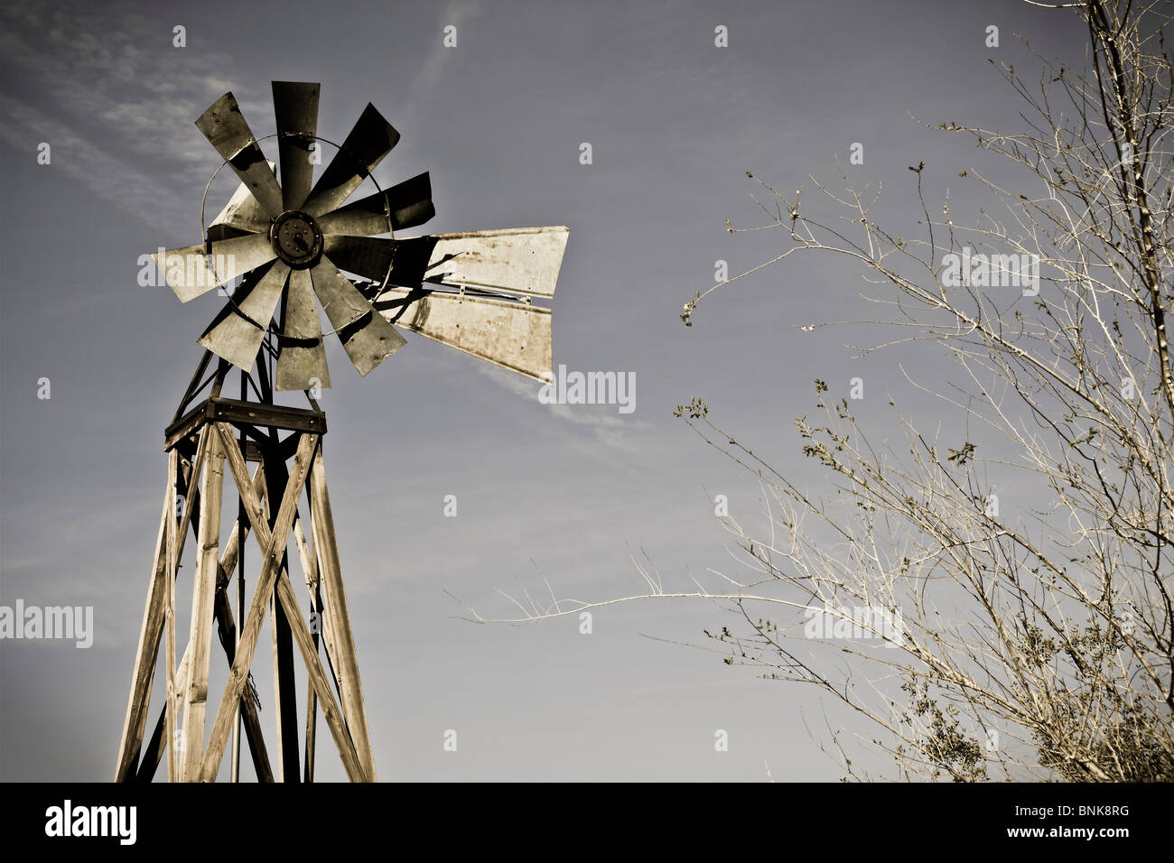 An old frontier style windmill. Stock Photo