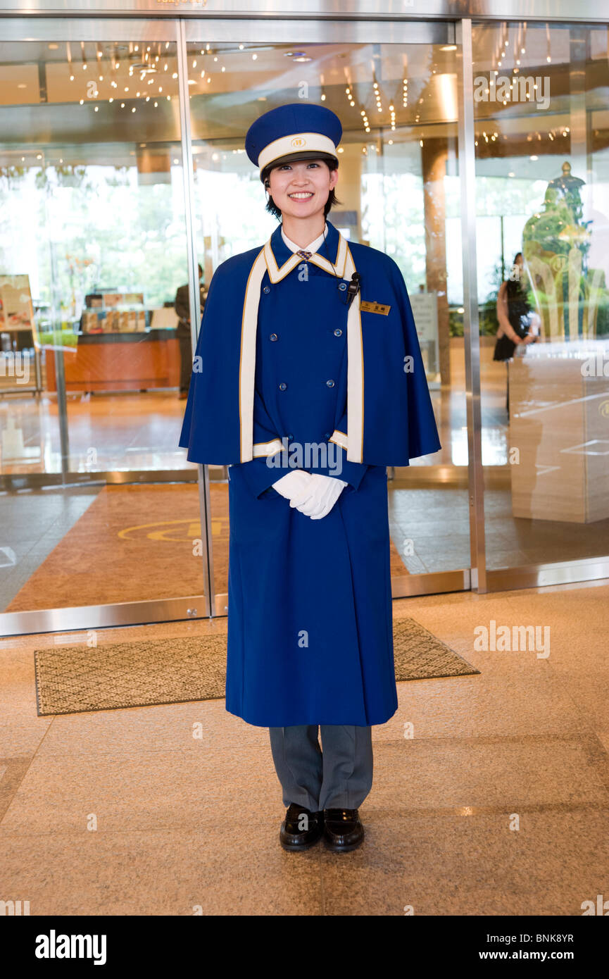 Hotel doorman outside entrance to the Hilton Tokyo Bay, Tokyo, Japan - Stock Image
