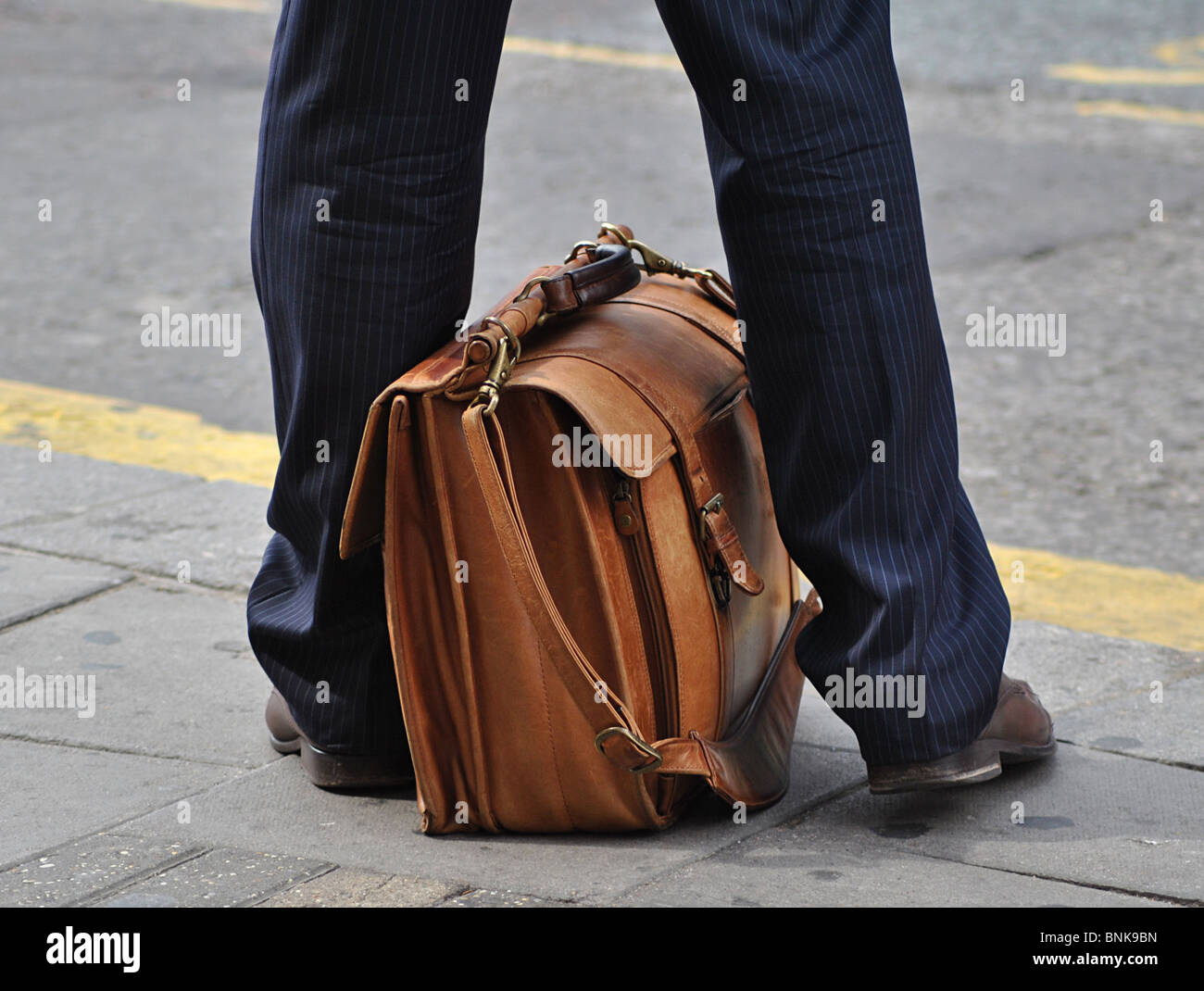 Businessman with briefcase, London - Stock Image