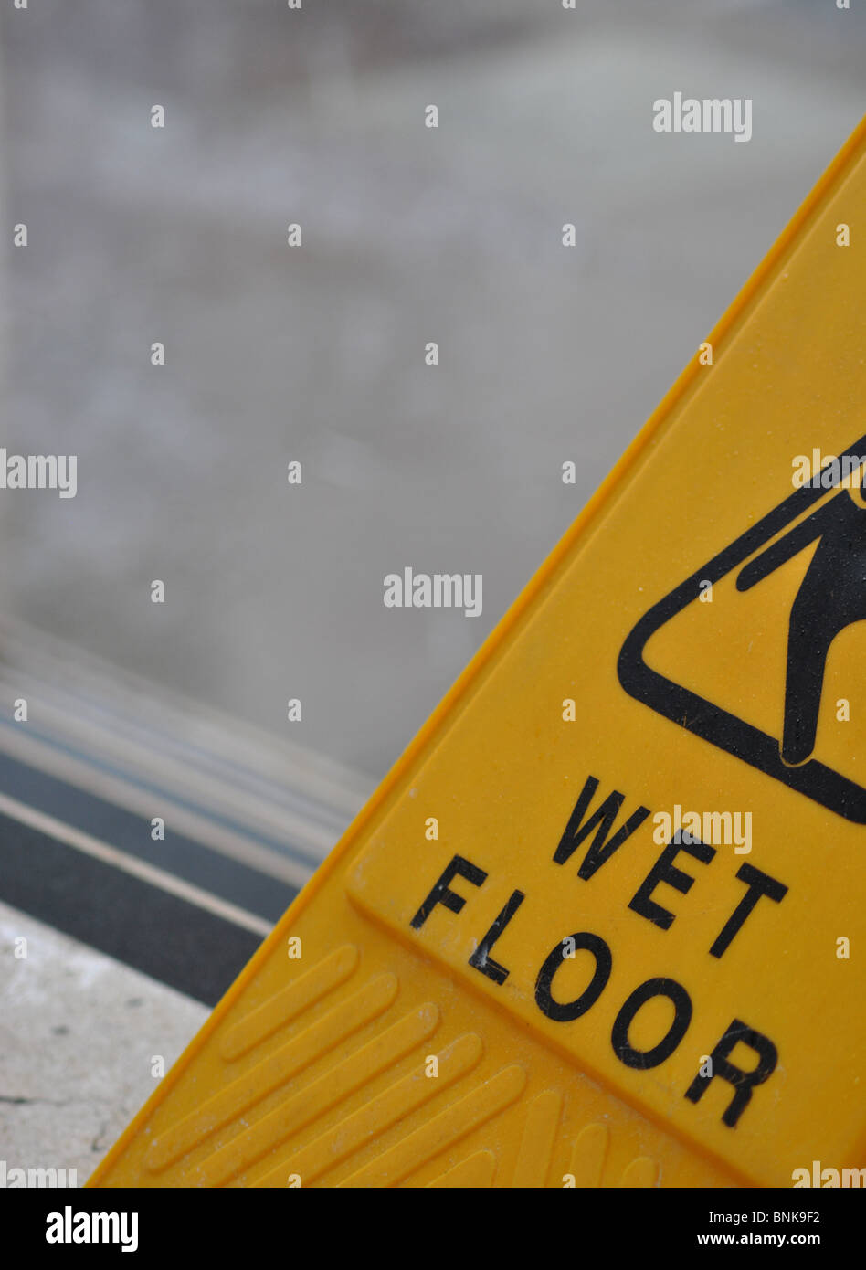 Wet floor sign, England - Stock Image