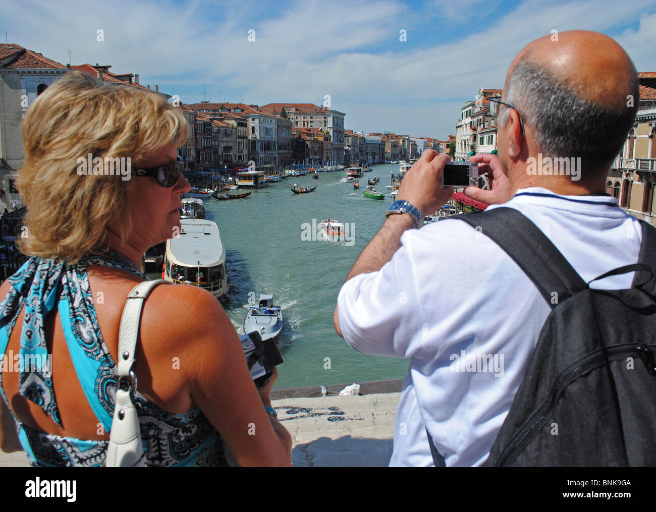 Tourists taking photos of the Grand Canal from the Rialto Bridge, Venice, Italy - Stock Image