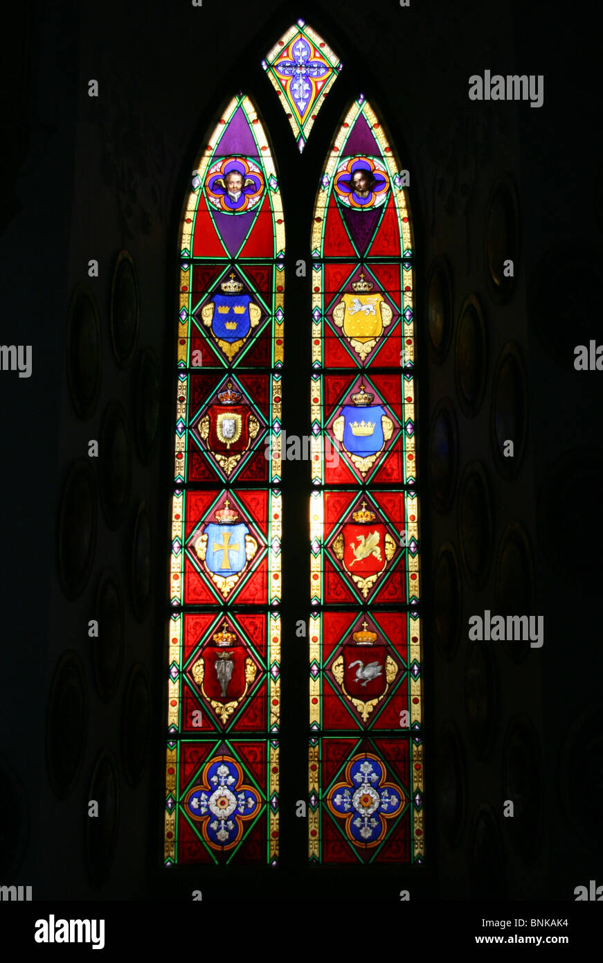 A stained glass window in the chapel of Frederiksborg Castle in Hilleroed, Denmark - Stock Image