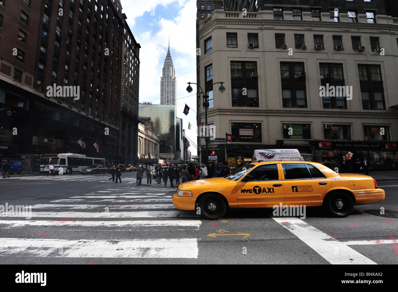 Yellow cab near the Chrysler building in Manhattan New York USA - Stock Image