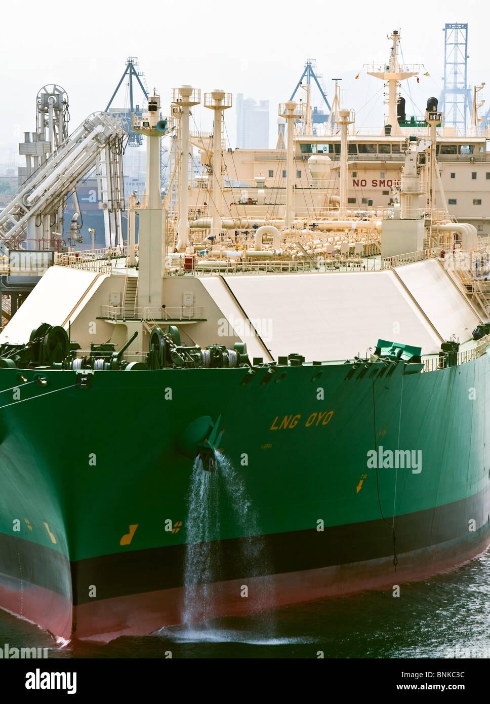 lng  tanker oyo discharging liquefied natural gas cargo at Barcelona terminal Stock Photo