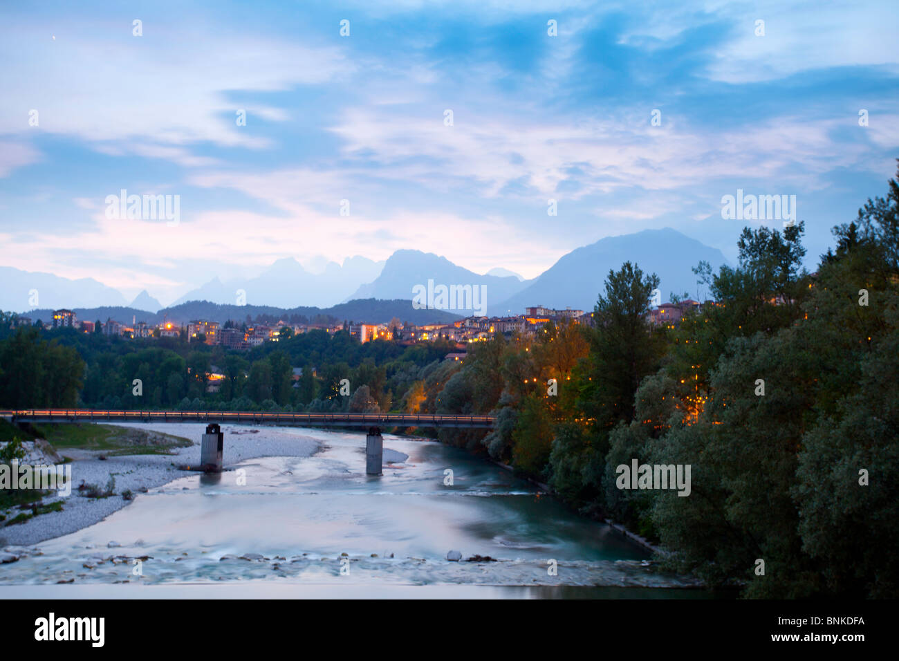 The mountain town of belluno captured at sunset with the dolomite mountains in the background - Stock Image