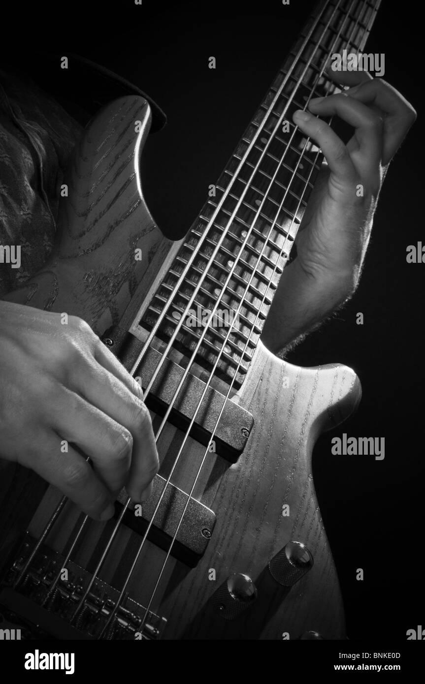 bass guitar line bassline guitars string strings player play playing man music musician musicians boom rock music - Stock Image