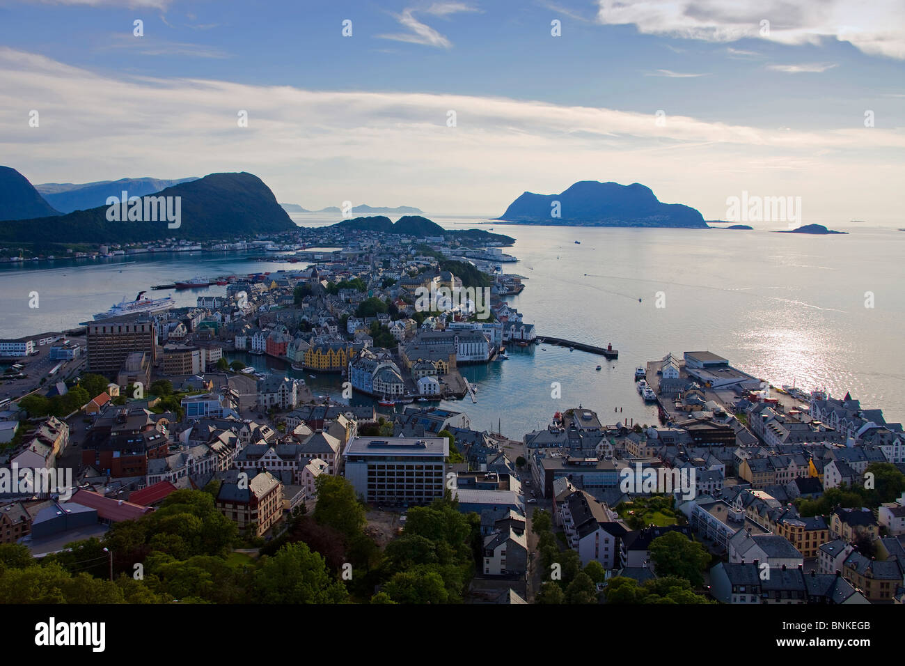 Norway Scandinavia ale sound town city houses homes harbour port Ueberischt midnight sun sea travel holidays vacation - Stock Image
