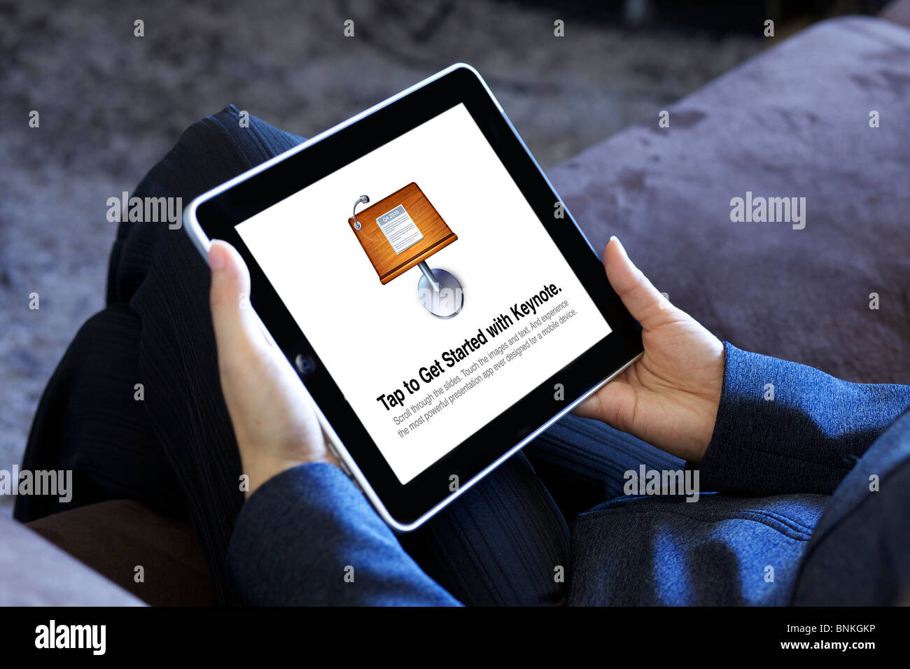 A business woman using Keynote app on an iPad to make presentations