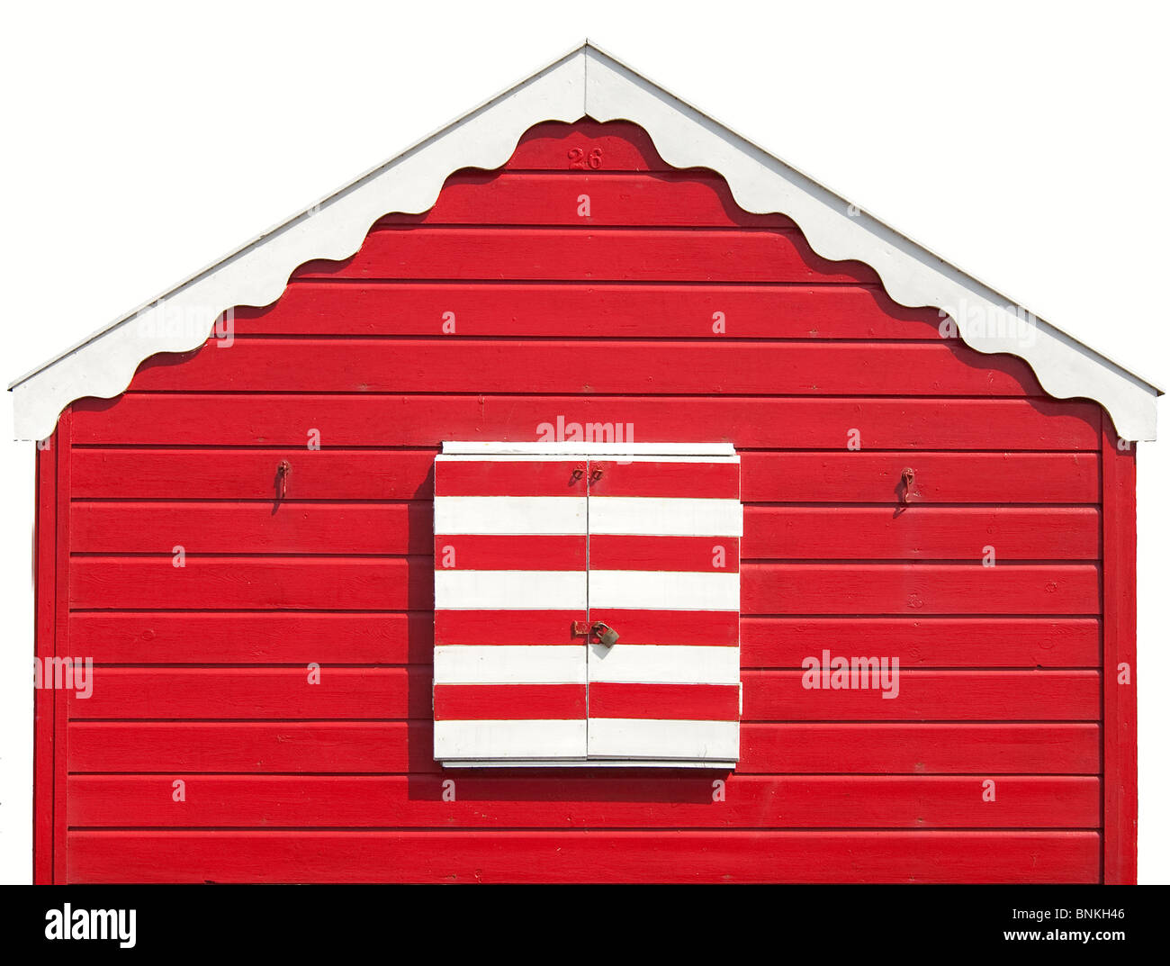 Isolated Colourful red white striped Beach Hut at the Beach of Southwold, England. - Stock Image