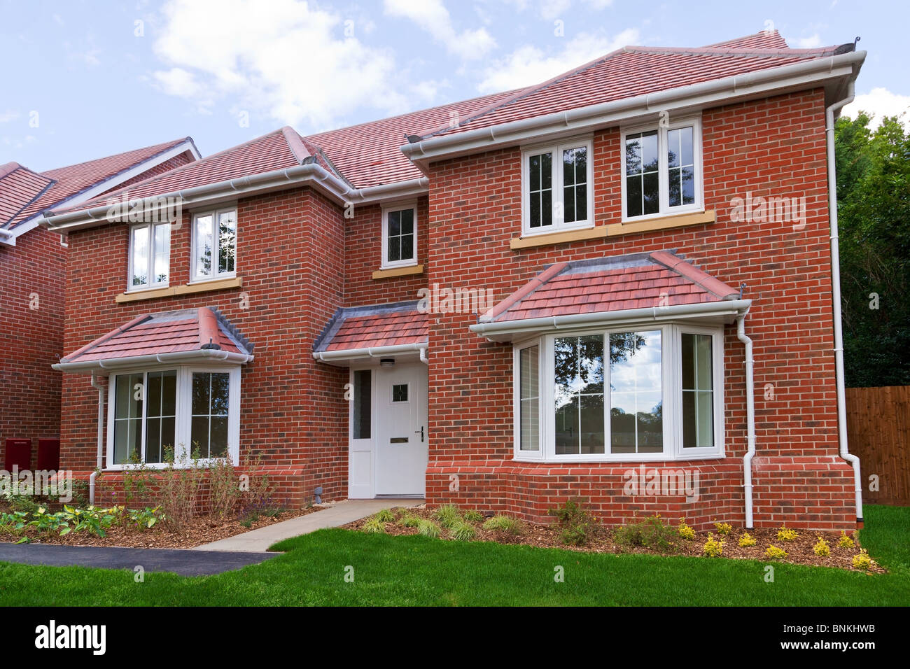 Photo of a brand new unoccupied detached red brick built five bedroom house on a modern housing development. - Stock Image