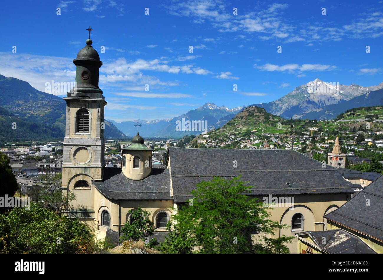 Switzerland Valais Sion Sion church architecture town city cathedral building construction classically Italian tower - Stock Image