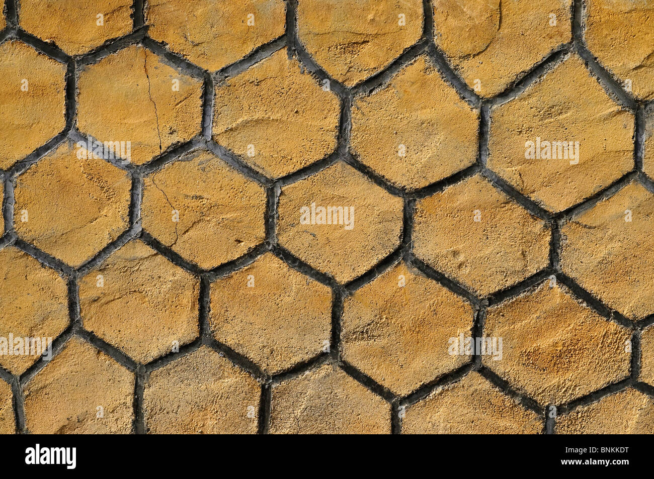 Exterior wall with false honeycomb tile effect - France. - Stock Image