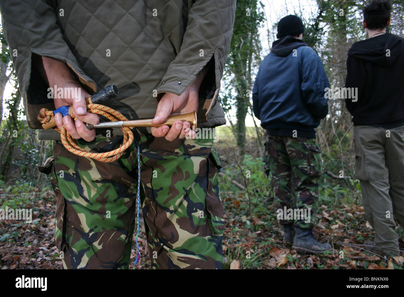 Hunt Saboteur holding hunting horn and home-made whip, Herefordshire, UK - Stock Image
