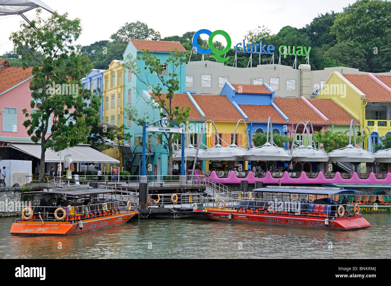 tourist boats on the Singapore River at Clarke Quay Stock Photo