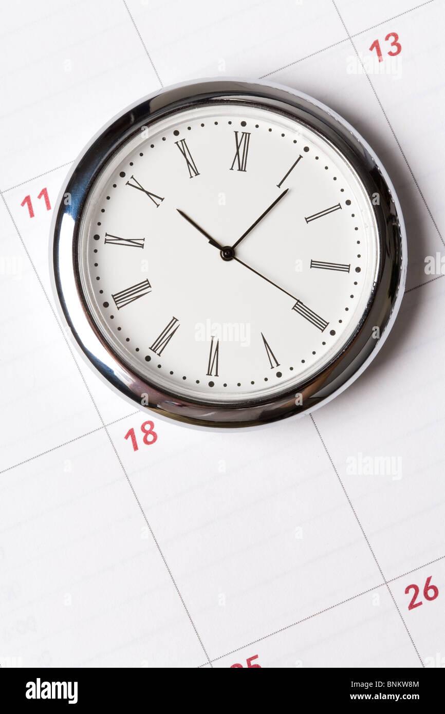 calendar and clock close up shot - Stock Image
