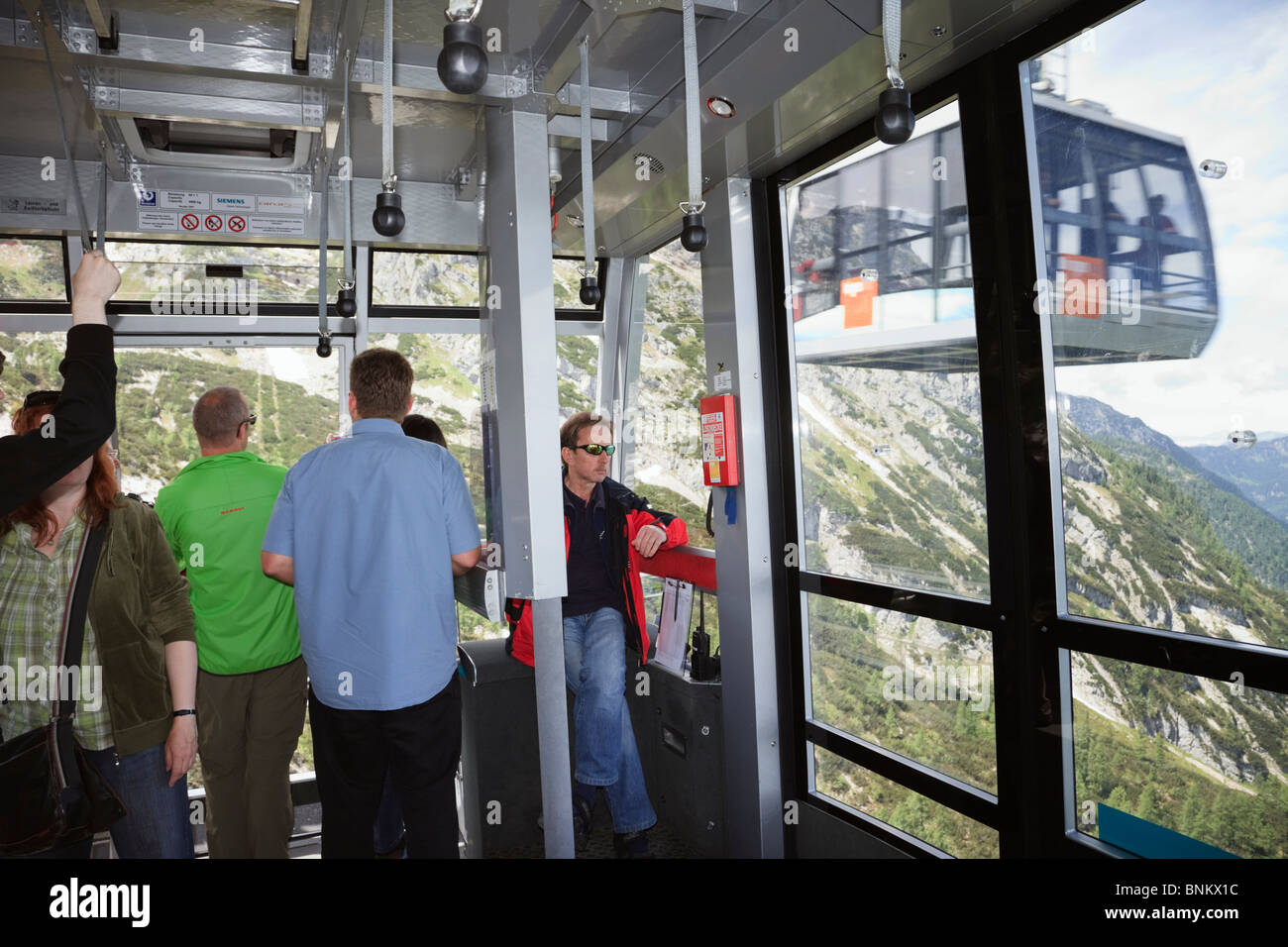 Obertraun, Salzkammergut, Austria. People inside the Dachstein World Heritage Cableway cablecar up to Krippenstein - Stock Image