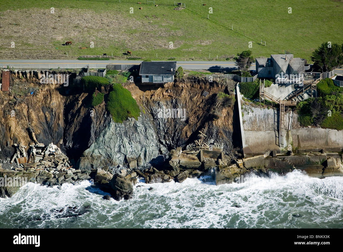 aerial above house ready to fall into the Pacific Ocean along Highway One in Sonoma County, California - Stock Image