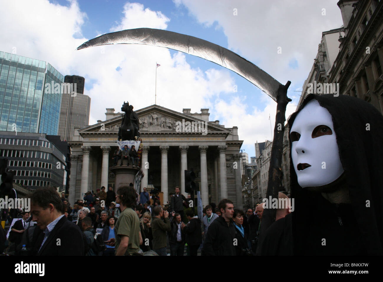 Protester dressed as the grim reaper with sythe over The Bank of England during G20 protests, London, UK - Stock Image