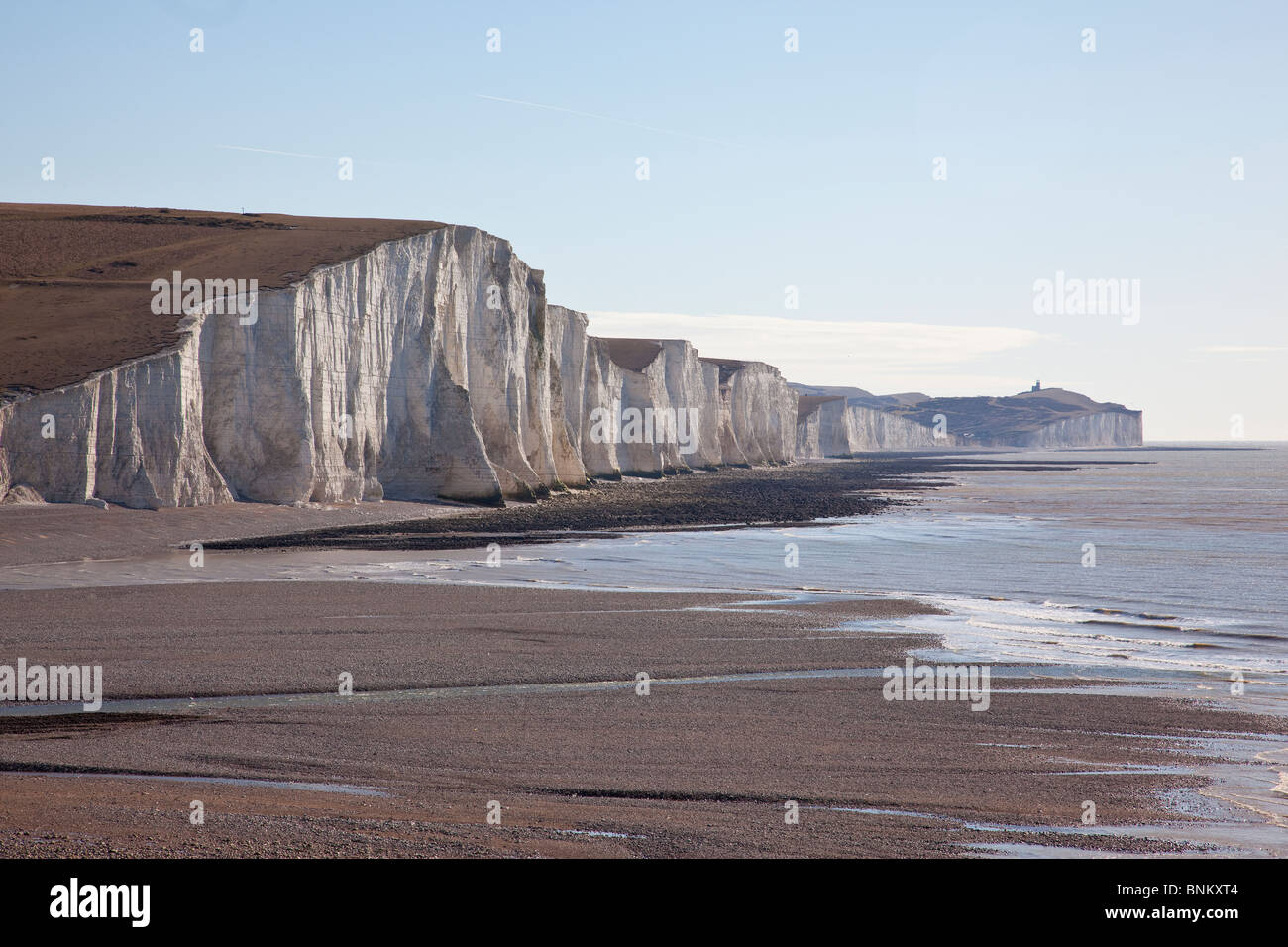 Coastguard cottages at Cuckmere Haven, Seaford, overlooking part of the Seven Sisters cliffs range, East Sussex, Stock Photo