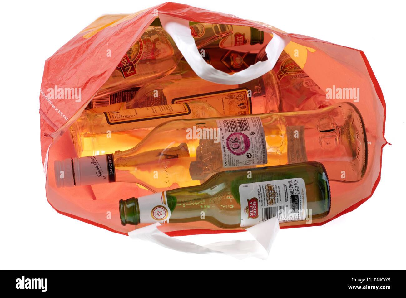 Orange bag full of empty bottles Stock Photo