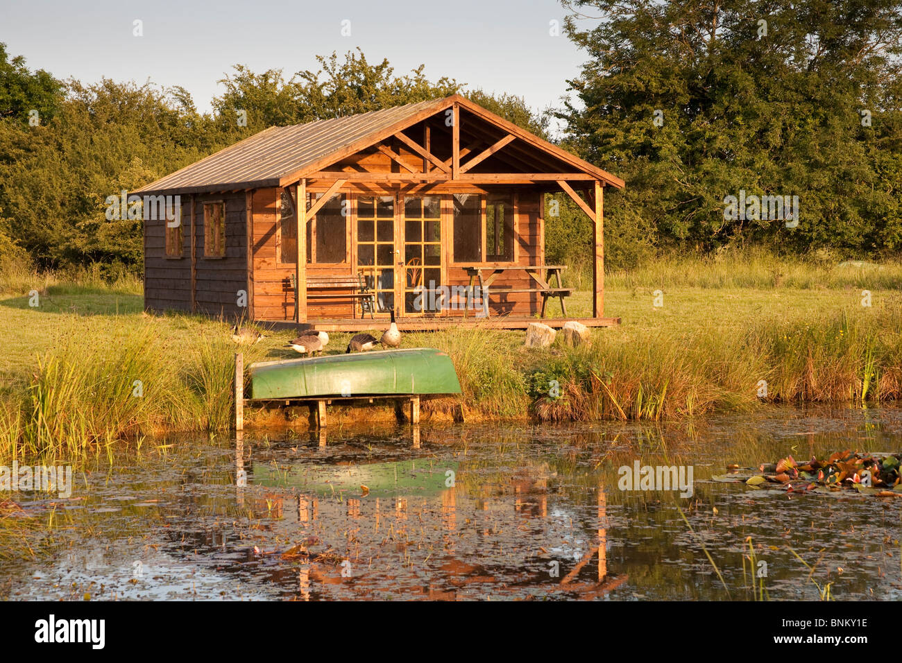 A summerhouse beside a lake, Wiltshire, England - Stock Image