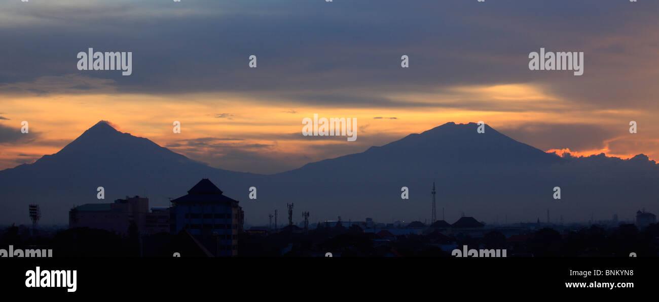 Indonesia, Java, Gunung Merapi and Gunung Merbabu volcanoes, sunset; - Stock Image