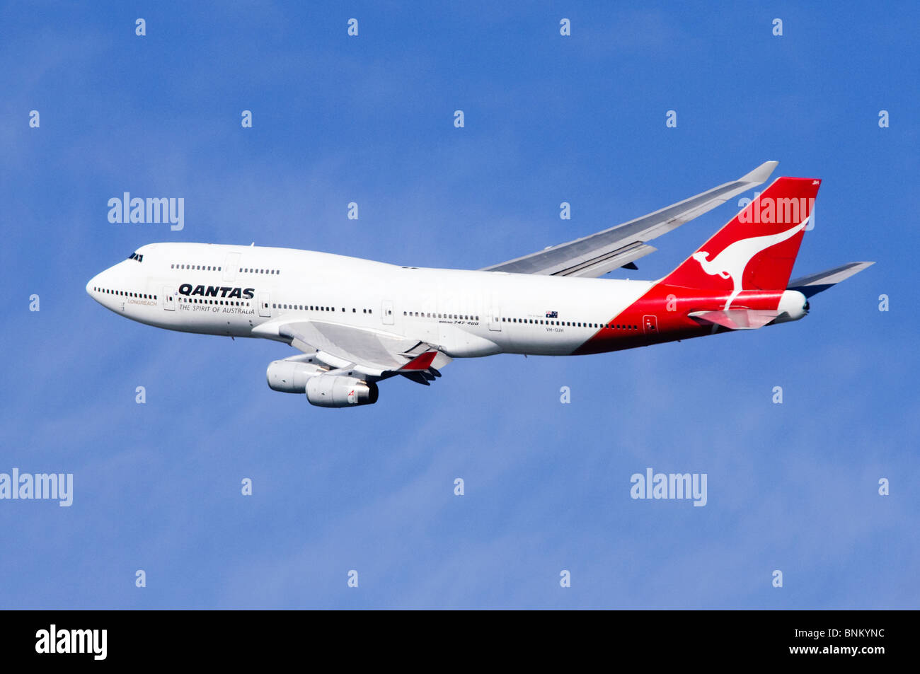 Boeing 747 operated by Qantas climbing out from take off at London Heathrow Airport, UK. - Stock Image