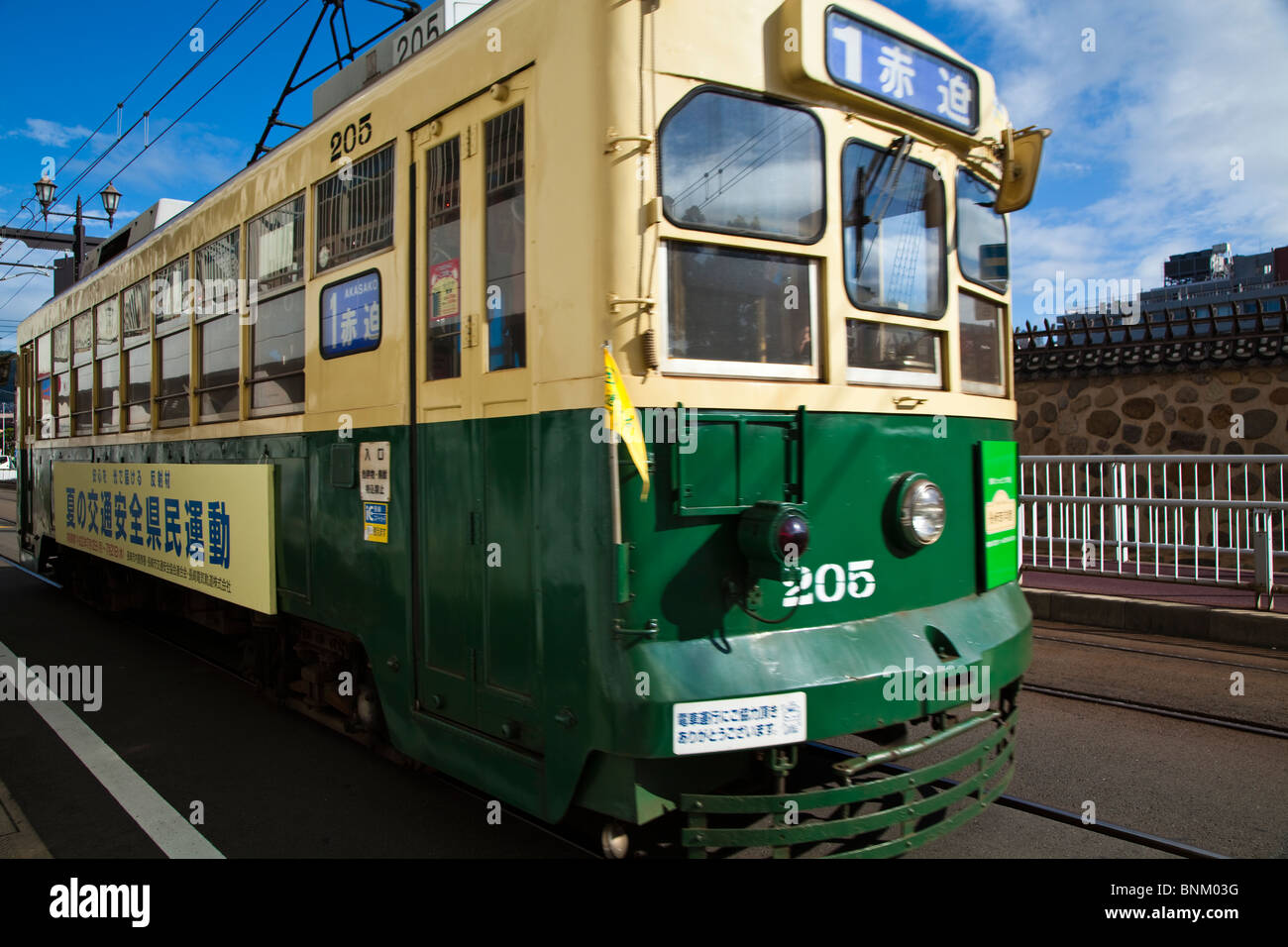 Nagasaki Electric Tramway is a private tram system in Nagasaki. The trams began service in 1915 and has been running - Stock Image