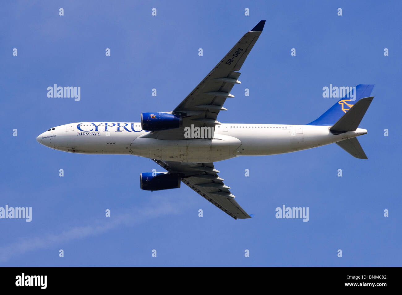 Airbus A330 operated by Cyprus Airways climbing out from take off at London Heathrow Airport, UK. - Stock Image