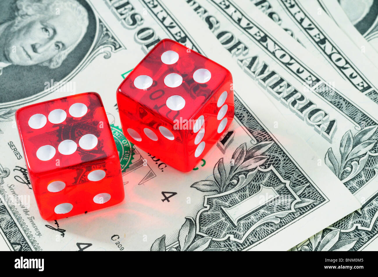 Winning Number Red Craps Dice On American Money - Stock Image