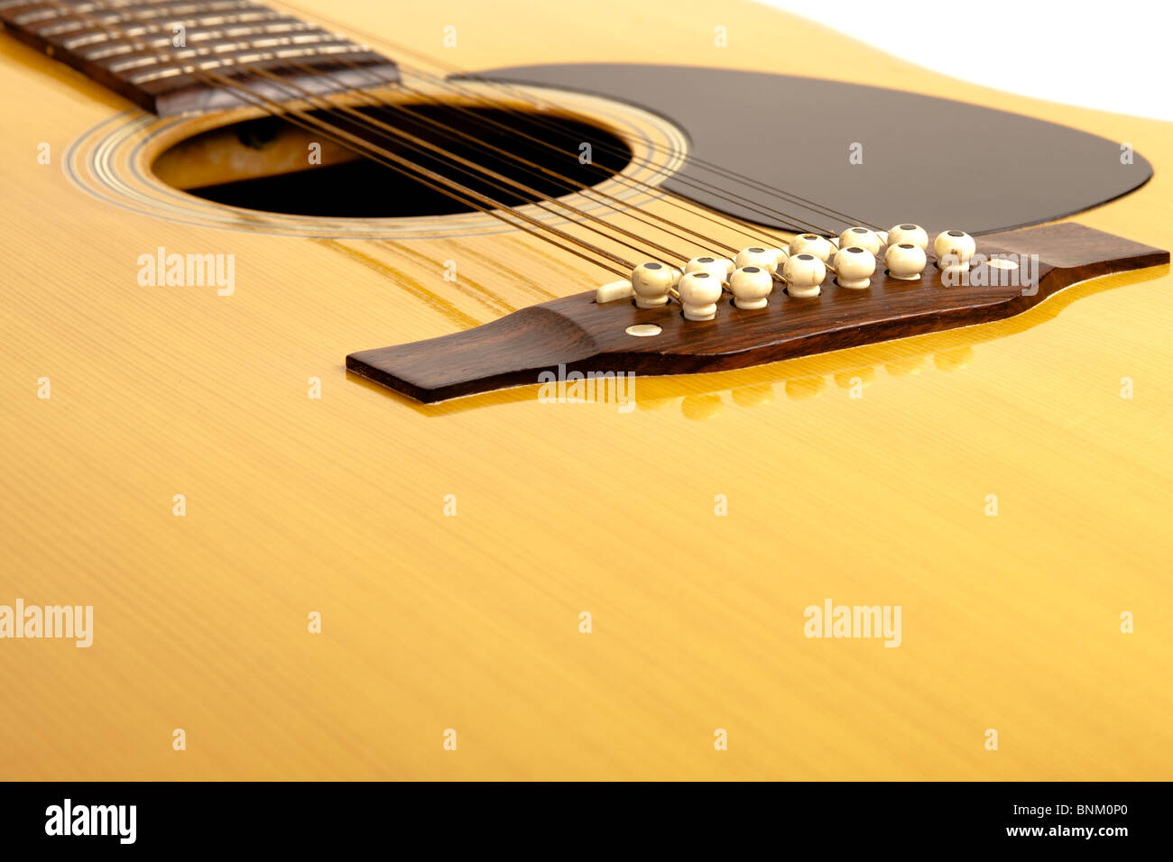 a 12 string acoustic guitar on white - Stock Image