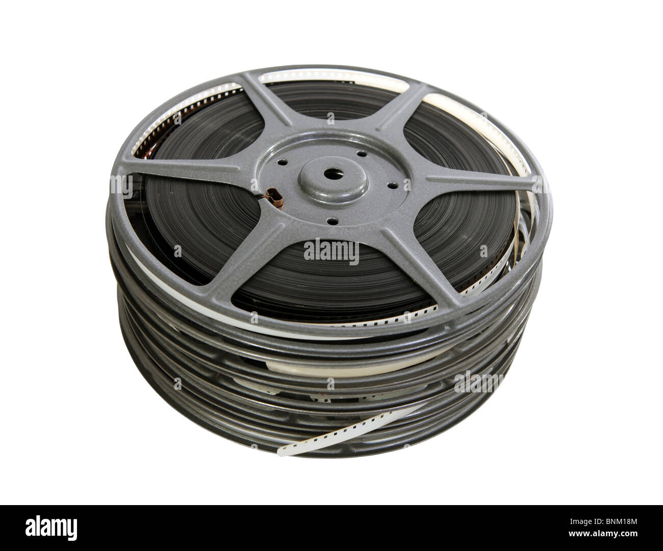 Old 8mm film reels with white leader. - Stock Image