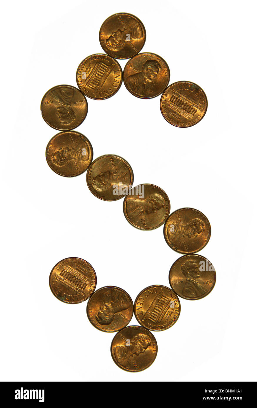 Cutout of US one cent coins money in dollar sign shape - Stock Image