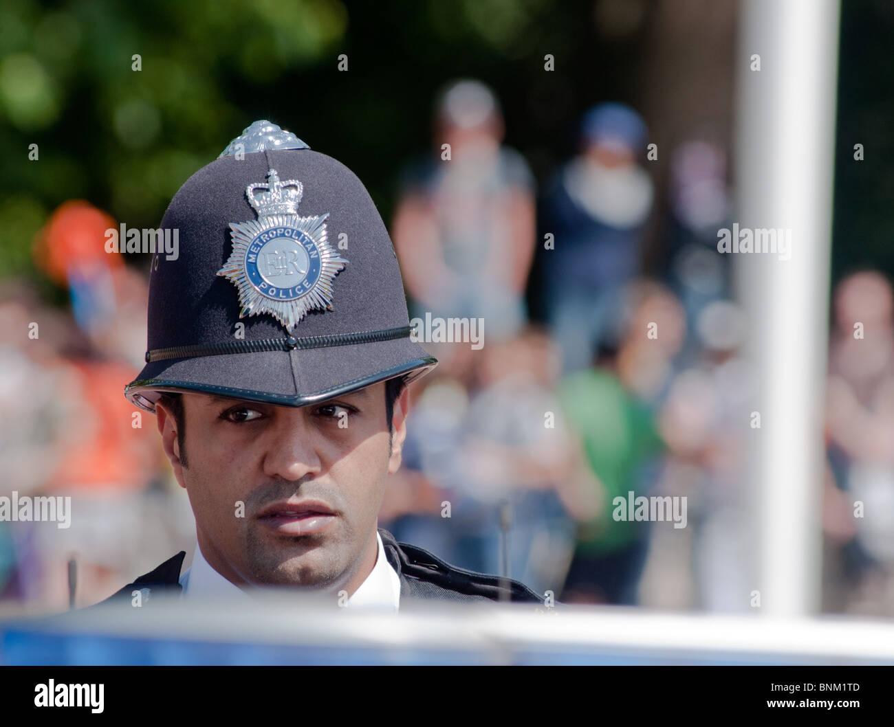 London bobby from ethnic minority background - Stock Image